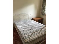 White framed bedframe with almost new mattress