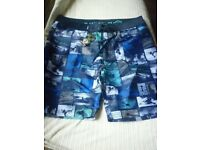 mens urban beach board shorts,new with tags on,size xxl..........
