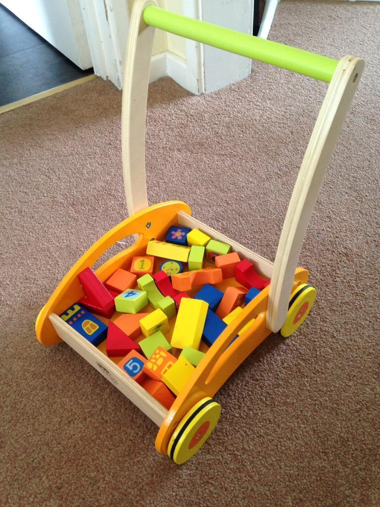 Baby's first wooden walker with blocks