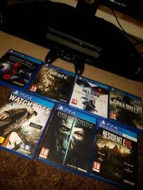 Ps4 slim with controller and 7 games 2 still sealed.