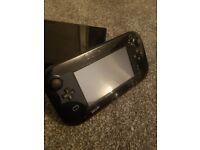 Nintendo Wii U with games