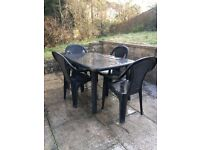 Outdoor plastic table and chairs
