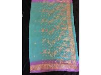 Ladies Indian Saree in a turquoise and light purple colour