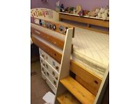Childrens mid-sleeper cabin bed with furniture