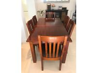 Six person dining table with expandable leaf and 6 chairs