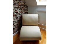 Cream leather rocker chair by Dwell
