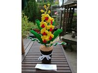 Crochet orchid with leaves& crochet pot+ a bow.