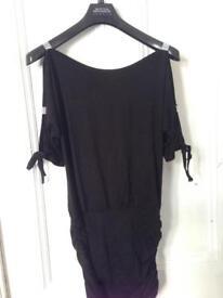 Women's black clubbing dress size medium.