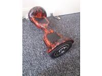 """10"""" Wheel Hoverboard (Bluetooth) (Red flame) used but in excellent condition"""