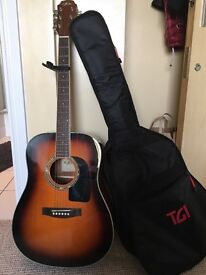 Acoustic guitar , it has a scrape on the neck but doesn't effect sound or looks of the guitar
