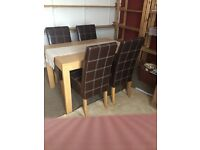 Table and four leather chaire