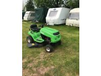 Sit on mower ready for action