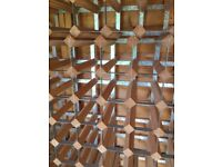 Wine racks - wooden. Have several of these - basically enough to house around 150 bottles