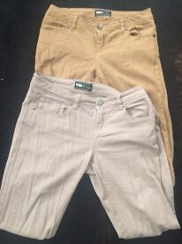Two pairs of beige skinny jeans size 10