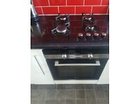 Integrated fridge freezer and cooker with hob