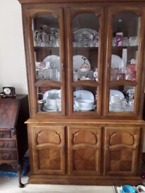 Large solid wood dresser. Bottom storage top display.