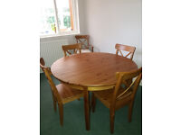 Extending dinning table and 5 chairs