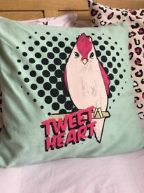 Mint-green, black, and pink parrot 'tweetheart' cushion