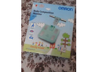 omron body composition monitor family model in turquoise