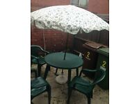 Garden table, 3 chairs and umbrella