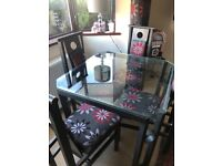 Glass table, 4 chairs, matching sofa, curtains & rug