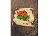 7 x ceramic flower wall plaques