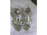 Silver heels worn once size 5