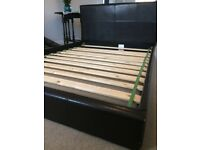 Low-height double bed frame with slatted base in good condition
