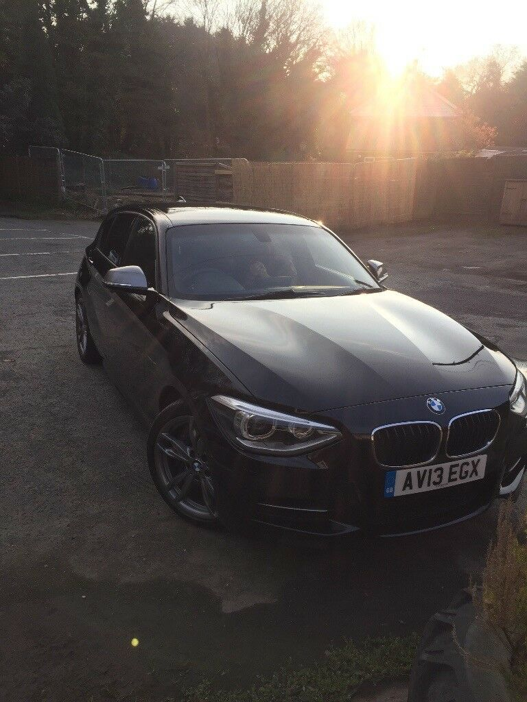 BMW 135i 5dr in black with black leather fsh