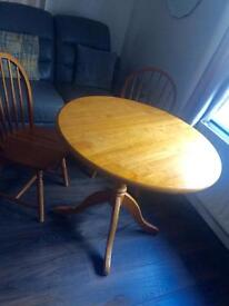 Solid round table with 2 chairs
