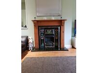 Retro cast iron fire surround with gas fire