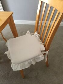 Lovely Harvey's light wood table & 6 fabric chairs