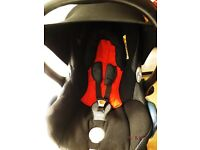 maxi cosi car seat in black with raincover and head hugger and adaptors to fit SOLA ,ZOOM ,URBO,