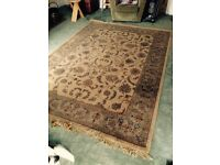 Large traditional pattern rug.