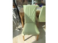 Excellent condtion 4 dining room chairs with covers, must be collected