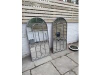 A pair of garden mirrors, architectural style with arched top