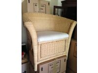 wicker ikea armchair. Pale fabric seating. Good condition but fabric could be cleaned or re-covered