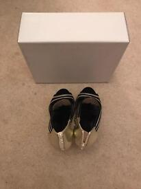 Carvella Size 5 black/gold heels. New!