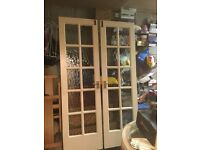 Pair of white double dining room doors with glazed glass panels