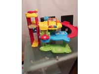 VTech Toot Toot Garage with Construction Site and Deluxe Train Track set