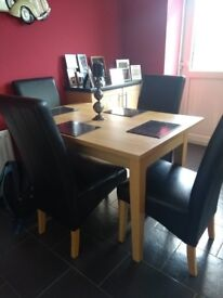 Heat resistant table and four leather chairs width 2ft.7x4ft-5ft £95