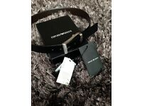 Authentic leather Emporio Armani belt. Used good condition black and brown reversible. With box