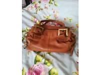 CLARKS tan soft leather small handbag.
