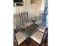 Glass table and chairs, dismantled, need van to pick up
