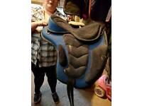 Black & blue synthetic treeless saddle