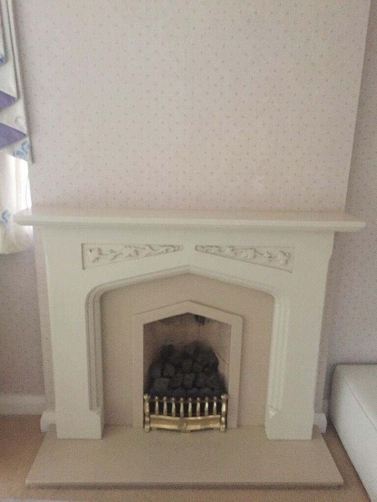 cream stone effect fire surround with brass grate marble hearth