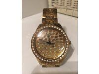Women's gold GUESS watch