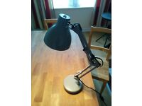 Adjustable metal desk lamp with LED bulb.