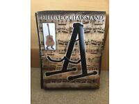 Deluxe guitar stand - brand new boxed