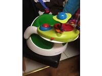 Snug bumbo seat and tray and toys